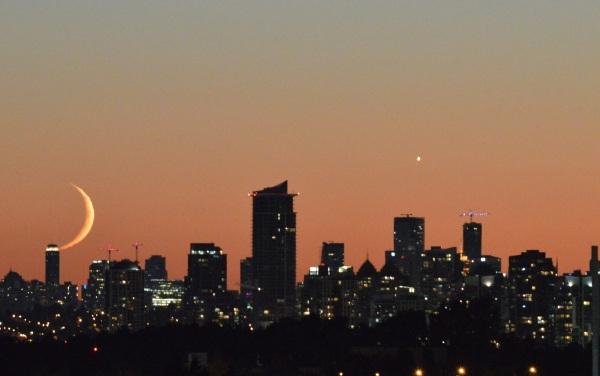 Moon kissing the skyline