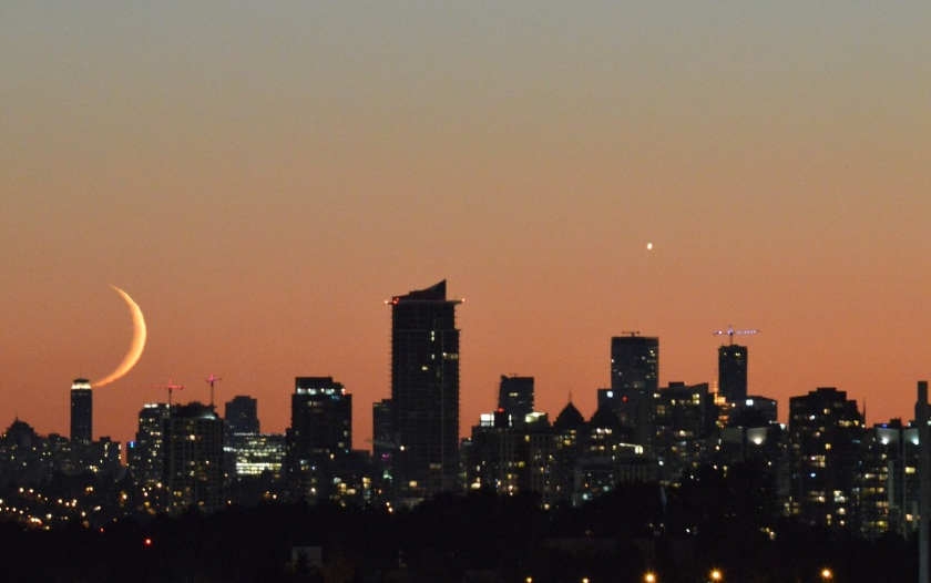 Moon kissing the skyline